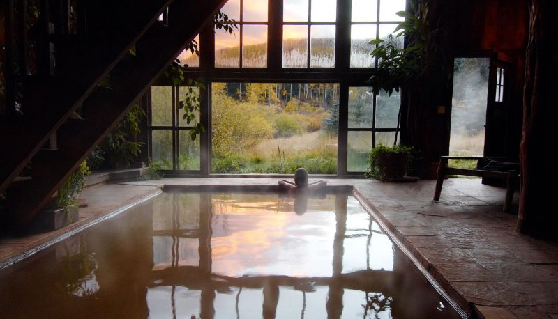 woman soaking at Dunton hot springs
